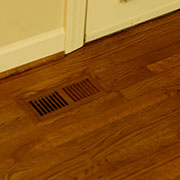 Completed oak flush mounted floor vent finished to match original floor