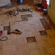Parquet flooring with pet stained wood removed
